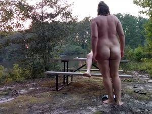 Mature couple fucks at river picnic at...