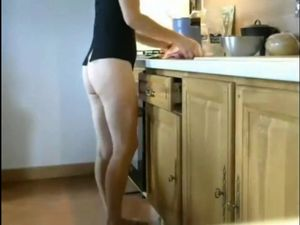 Leggy mature mom cooking with...