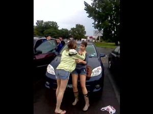 Two drunk girls kissing and rubs each...